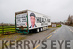 Articulated trailer decorated with Michael Healy Rae posters parked in the Go Safe parking place at the Six Crosses, Listowel on Sunday last and posters for independent Michael O'Gorman also on the fence without the election date being announced.