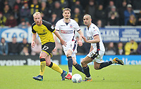 Bolton Wanderers Dorian Dervite in action with Burton Albion's Liam Boyce<br /> <br /> Photographer Mick Walker/CameraSport<br /> <br /> The EFL Sky Bet Championship - Burton Albion v Bolton Wanderers - Saturday 28th April 2018 - Pirelli Stadium - Burton upon Trent<br /> <br /> World Copyright &copy; 2018 CameraSport. All rights reserved. 43 Linden Ave. Countesthorpe. Leicester. England. LE8 5PG - Tel: +44 (0) 116 277 4147 - admin@camerasport.com - www.camerasport.com