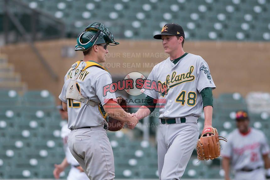 Mesa Solar Sox relief pitcher Nolan Blackwood (48) talks to catcher Sean Murphy (12), both of the Oakland Athletics organization, during an Arizona Fall League game against the Salt River Rafters on October 30, 2017 at Salt River Fields at Talking Stick in Scottsdale, Arizona. The Solar Sox defeated the Rafters 8-4. (Zachary Lucy/Four Seam Images)