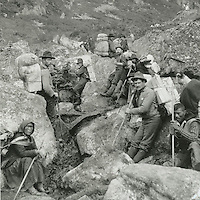 KLGO Photo Station CH-05: Long Hill, 1897, View north of prospectors and packers on the Chilkoot Trail on Long Hill one mile north of Sheep Camp, Klondike Gold Rush National Historical Park, Alaska, United States. Photo by Frank La Roche.