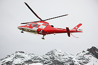 """Switzerland. Canton Ticino. Chironico valley. A Rega Agusta AW109 SP Grand """"Da Vinci"""" helicopter on a rescue mission. All Rega helicopters carry a crew of three: a pilot, an emergency physician and a paramedic who is also trained to assist the pilot for radio communication, navigation, terrain/object avoidance, and winch operations. The name Rega was created by combining letters from the name """"Swiss Air Rescue Guard"""" as it was written in German (Schweizerische Rettungsflugwacht), French (Garde Aérienne Suisse de Sauvetage), and Italian (Guardia Aerea Svizzera di Soccorso). Rega is a private, non-profit air rescue service that provides emergency medical assistance in Switzerland. Rega mainly assists with mountain rescues, though it will also operate in other terrains when needed, most notably during life-threatening emergencies. As a non-profit foundation, Rega does not receive financial assistance from any government. People in distress can call for a helicopter rescue directly (phone number 1414). The AgustaWestland AW109 is a lightweight, twin-engine, helicopter built by the Italian manufacturer Leonardo S.p.A. (formerly AgustaWestland, Leonardo-Finmeccanica and Finmeccanica). Leonardo S.p.A is an Italian global high-tech company and one of the key players in aerospace. In close collaboration with the manufacturer, the Da Vinci has been specially designed to cater for Rega's particular requirements as regards carrying out operations in the mountains. It optimally fulfills the high demands made of it in terms of flying characteristics, emergency medical equipment and maintenance. Safety, performance and space have been increased, and maintenance and noise emissions reduced. The Chironico valley is a valley lateral to the Levantina valley. 10.09.2017 © 2017 Didier Ruef"""