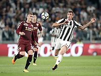Calcio, Serie A: Torino, Allianz Stadium, 23 settembre 2017. <br /> Juventus' Mario Mandzukic (r) in a action with Torino's Evamgelista Lyanco (l) during the Italian Serie A football match between Juventus and Tori0i at Torino's Allianz Stadium, September 23, 2017.<br /> UPDATE IMAGES PRESS/Isabella Bonotto