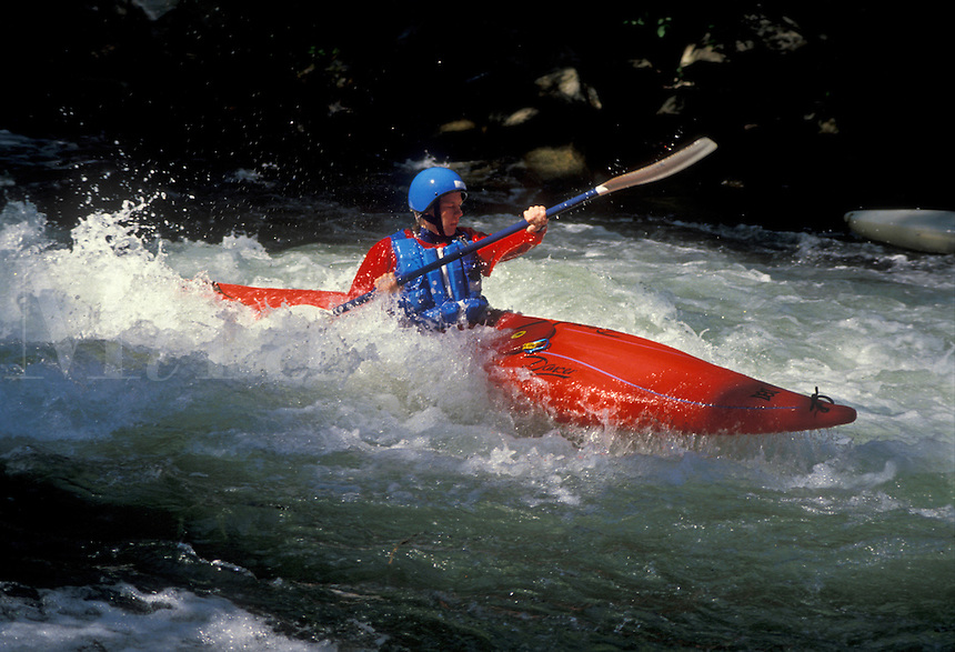AJ1721, kayaking, white water, North Carolina, Man kayaking in a red kayak in white water on the Nantahala River in the Appalachian Mountains.