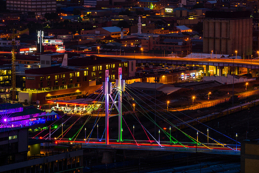 The Nelson Mandela Bridge connects the Braamfontein and ...