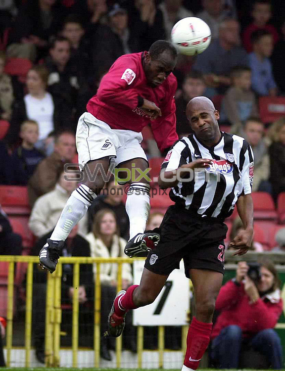 Pix: Chris Whiteoak/SWpix.com. Football. Coca Cola League 2. Grimsby Town v Swansea, 30/10/2004...COPYRIGHT PICTURE>>SIMON WILKINSON>>01943 608782>>..Swansea's Adrian Forbes gets to the head before Grimsby's Dean Gordan