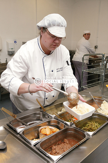 In the Hospital Kitchens special dietary meals being put into polystyrene containers for specific inpatients,