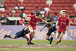 Matt Mullins of Canada runs with the ball while American players try to stop him during the match United States vs Canada, the Cup Final of the HSBC Singapore Rugby Sevens as part of the World Rugby HSBC World Rugby Sevens Series 2016-17 at the National Stadium on 16 April 2017 in Singapore. Photo by Victor Fraile / Power Sport Images