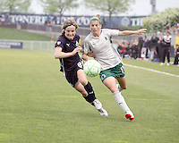 Sonia Bompastor #8 of the Washington Freedom races for the ball with Angie Woznuk #11 of St. Louis Athletica during a WPS match at the Maryland Soccerplex on May 3, 2009 in Boyds Maryland. The game ended in a 3-3 tie.