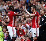 Paul Pogba of Manchester United replaced by Michael Carrick of Manchester United just before half time during the English Premier League match at the Old Trafford Stadium, Manchester. Picture date: May 21st 2017. Pic credit should read: Simon Bellis/Sportimage