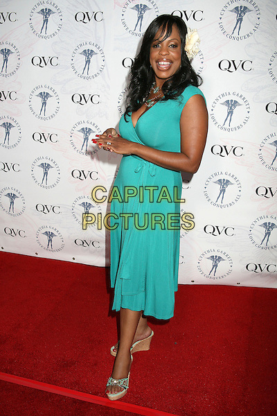 """NIECY NASH.QVC and Cynthia Garrett Celebrate Her """"Love Conquers All"""" Jewelry Collection Debut, Hollywood, California, USA..August 22nd, 2006.Ref: ADM/BP.full length turquoise flower in hair dress.www.capitalpictures.com.sales@capitalpictures.com.©Byron Purvis/AdMedia/Capital Pictures."""