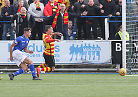 Barry Maguire fouling Scott McDonald to concede a penalty in the SPFL Ladbrokes Championship football match between Queen of the South and Partick Thistle at Palmerston Park, Dumfries on  4.5.19.