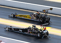 Sep 14, 2013; Charlotte, NC, USA; NHRA top alcohol dragster driver Bill Reichert (top) races alongside Marty Thacker during qualifying for the Carolina Nationals at zMax Dragway. Mandatory Credit: Mark J. Rebilas-