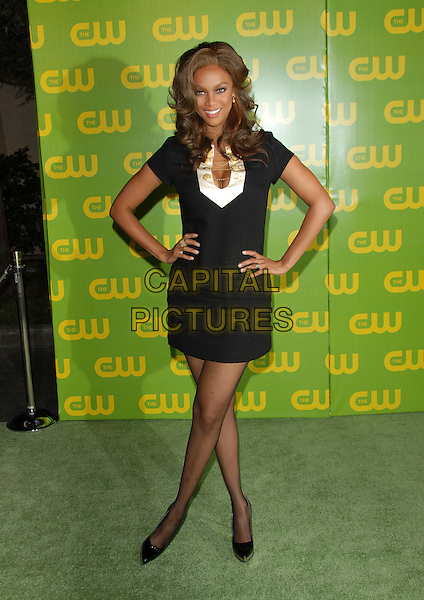 TYRA BANKS.The CW Launch Party held at Warner Brothers' Studios in Burbank, California, USA..September 18th, 2006.Ref: DVS.full length black dress white hands on hips.www.capitalpictures.com.sales@capitalpictures.com.©Debbie VanStory/Capital Pictures