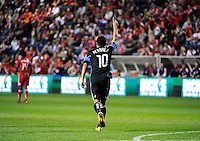 San Jose forward Arturo Alvarez (10) raises his hand after scoring the game's first goal during the second half of a match between the San Jose Earthquakes and the Chicago Fire at Toyota Park in Bridgeview, IL on April 10, 2010.  San Jose Earthquakes 2, Chicago Fire 1.