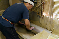 A potter kneading clay at the Mori Touki kiln (Otani pottery), Naruto, Tokushima Prefecture, Japan, July 8, 2014. The city of Naruto in Tokushima Japan is famous for whirlpools that form in the Naruto Strait. It is home to Otani pottery and the first two temples on the Shikoku 88 temple pilgrimage.
