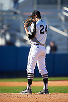 Wisconsin-Milwaukee Panthers starting pitcher Jay Peters (24) looks in for the sign during a game against the Bethune-Cookman Wildcats on February 26, 2016 at Chain of Lakes Stadium in Winter Haven, Florida.  Wisconsin-Milwaukee defeated Bethune-Cookman 11-0.  (Mike Janes/Four Seam Images)
