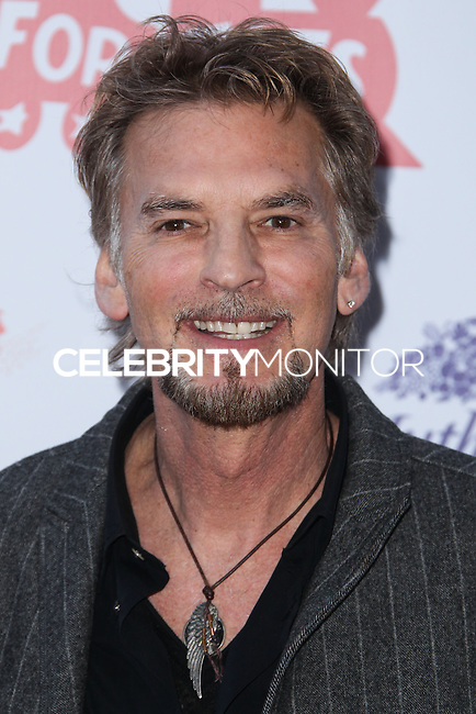 HOLLYWOOD, CA - DECEMBER 01: Kenny Loggins arriving at the 82nd Annual Hollywood Christmas Parade held at Hollywood Boulevard on December 1, 2013 in Hollywood, California. (Photo by Xavier Collin/Celebrity Monitor)