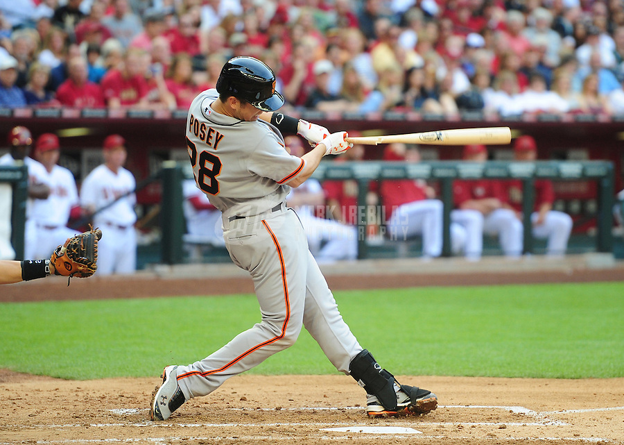 Apr. 6, 2012; Phoenix, AZ, USA; San Francisco Giants catcher Buster Posey hits a single in the third inning against the Arizona Diamondbacks during opening day at Chase Field.  Mandatory Credit: Mark J. Rebilas-