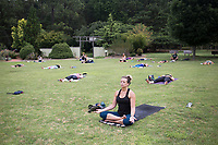 Melanie Austin of Fayetteville meditates, Saturday, June 20, 2020 at the Botanical Gardens of the Ozark in Fayetteville. Fayetteville Yoga Fest hosted a yoga class with about 60 people on the lawn of the garden to celebrate the summer solstice, the first day of summer and longest day of the year. Check out nwaonline.com/200621Daily/ for today's photo gallery. <br /> (NWA Democrat-Gazette/Charlie Kaijo)