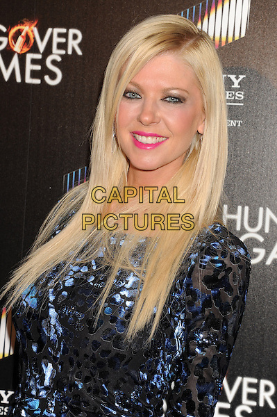 HOLLYWOOD, CA - FEBRUARY 11: Tara Reid attends the premiere of 'The Hungover Games' at the TCL Chinese 6 Theatres on February 11, 2014 in Hollywood, California.<br /> <br /> CAP/LNC/JM<br /> &copy;JM/LNC/Capital Pictures