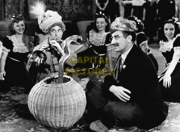 The Marx Brothers, Harpo and Groucho Surrounded by The Four Dreamers  .in The Big Store.*Filmstill - Editorial Use Only*.CAP/PLF.Supplied by Capital Pictures.