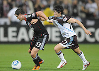 DC United midfielder Chris Pontius (13) shields the ball against Colorado Rapids defender Kosuke Kimura (27)   DC United tied The Colorado Rapids 1-1, at RFK Stadium, Saturday  May 14, 2011.