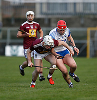 2nd February 2020; TEG Cusack Park, Mullingar, Westmeath, Ireland; Allianz Division 1 Hurling, Westmeath versus Waterford; Allan Devine (Westmeath) lifts the ball under pressure from Kieran Power (Waterford)