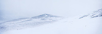 2006 Yukon Quest musher descends in near whiteout conditions from Eagle Summit in route to Central, Alaska.