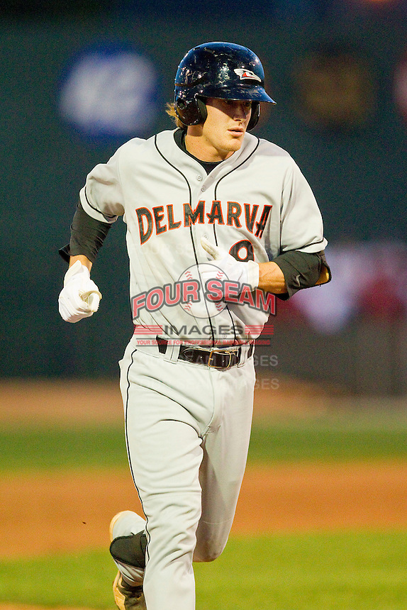 Creede Simpson (9) of the Delmarva Shorebirds rounds the bases after hitting a home run against the Hagerstown Suns at Municipal Stadium on April 11, 2013 in Hagerstown, Maryland.  The Shorebirds defeated the Suns 7-4 in 10 innings.  (Brian Westerholt/Four Seam Images)