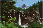 A color postcard view of Bridal Veil Falls and the Smuggler-Union power house.  The Three Needles peak is in the background.<br /> Pandora, CO  Taken by Reid, Homer