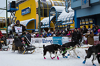 Rick Casillo and team leave the ceremonial start line with an Iditarider and handler at 4th Avenue and D street in downtown Anchorage, Alaska on Saturday March 3rd during the 2018 Iditarod race. Photo ©2018 by Brendan Smith/SchultzPhoto.com