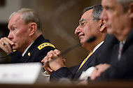 February 14, 2012  (Washington, DC)  Secretary of Defense, Leon Panetta (center) listens to a member of the Senate Armed Services Committee during a hearing on the FY2013 defense budget.  Chairman of the Joint Chiefs of Staff, General Martin Dempsey (left), and Under Secretary of Defense (Comptroller) Robert Hale (right).   (Photo by Don Baxter/Media Images International)