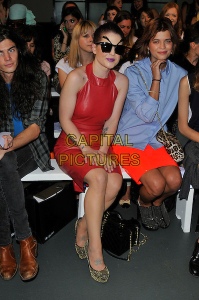 Matthew Mosshart, Kelly Osbourne & Pixie Geldof .At London Fashion Week, London, England..September 17th, 2012 .LFW full length blue shirt brown leopard print bag purse orange red leather skirt black shoes sunglasses shades dress sleeveless sitting eyebrows funny couple .CAP/WIZ.© Wizard/Capital Pictures.