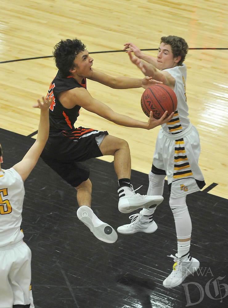 NWA Democrat-Gazette/MICHAEL WOODS &bull; @NWAMICHAELW<br /> Gravette's Kyle Fox (24) drives to the hoop past Prairie Grove defender Isaac Disney (3) Tuesday January 26, 2016 during their game at Prairie Grove High School.