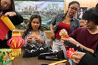 Cynthia Tim, 20, (starting second from right), Socheata Mam, 19, and Sunwoo Kang, 22, create paper lantern crafts at a Lunar New Year celebration at Middlesex Community College's Asian American Connections Center on Thurs., Feb. 15, 2018. Tim is a Cambodian-American and a second year student at Middlesex Community College studying Business. Mam is a Cambodian-American first year student studying Criminal Justice. Kang is a foreign student from South Korea. The Asian American Connections Center was established at the school using a federal grant in 2016 and serves as a focal point for the Asian community at the school, predominantly Cambodian, to gather, socialize, study, and otherwise take part in student life.