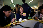 Elvira Quintero, 17, center, has lunch with friends in the cafeteria at Central Park East High School in New York, NY on November 15, 2012. Beyond sheer physical safety, a look at how schools and sitricts can create classroom conditions in which students are able to engage enthusiastically and without emotional fear of stepping forward. Photographer: Melanie Burford/Prime