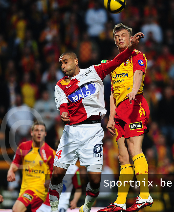 20110416 - LENS , FRANCE : RC Lens'  DAVID POLLET (right) pictured with Brest's  Ahmed Kantari (left) during the soccer match between Racing Club de LENS and BREST , on the thirty first  matchday in the French Ligue 1 at the Stade Bollaert Delelis stadium , Lens . Saturday 16 April 2011 . PHOTO DAVID CATRY