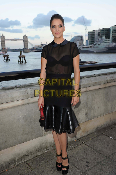 Julie Gonzalo.The Channel 5 Launch Party for the new series of 'Dallas', Old Billingsgate Market, London, England..21st August 2012.full length black dress skirt sheer blouse see through thru bra platform peep toe shoes .CAP/CAS.©Bob Cass/Capital Pictures.