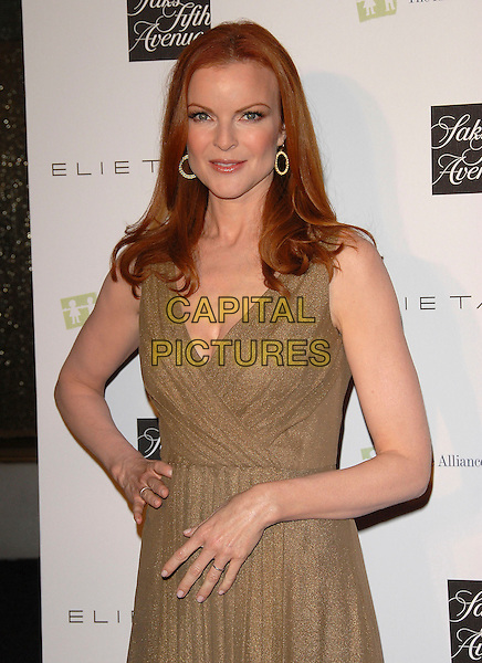 MARCIA CROSS.attends The Elie Tahari Boutique Opening within Saks Fifth Avenue in Beverly Hills, California, USA, October 16 2007..half length green dress khaki hand on hip                                                   .CAP/DVS.©Debbie VanStory/Capital Pictures