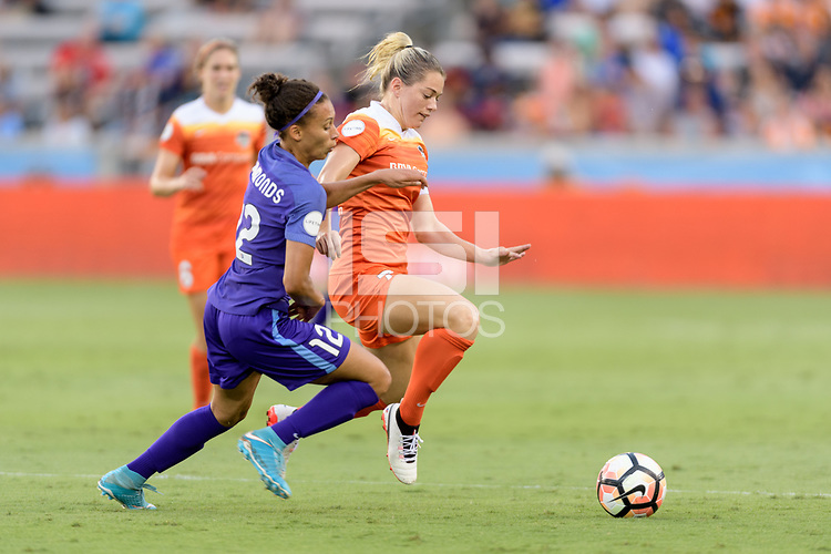 Houston, TX - Saturday June 17, 2017: Kristen Edmonds and Kealia Ohai chase after a loose ball during a regular season National Women's Soccer League (NWSL) match between the Houston Dash and the Orlando Pride at BBVA Compass Stadium.