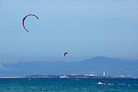Kite surfers at Playa de los Lances, Tarifa, Andalusia, Spain.