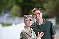 US Military Off Duty woman happy at home with husband. Model released, DOD compliant for commercial use.