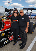 Jul 8, 2017; Joliet, IL, USA; NHRA top fuel driver Chris Karamesines (right) with granddaughter Krista Baldwin during qualifying for the Route 66 Nationals at Route 66 Raceway. Mandatory Credit: Mark J. Rebilas-USA TODAY Sports