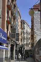 Walking along the Ramblers showing shops, buildings and apartments.  Llieda, Cataluna, Spain.