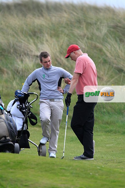 Jack Hume (Naas) and John Rooney (MD Flogas) on the 8th during the Flogas Irish Amateur Open Championship Am-Am at Royal Dublin on Monday 9th May 2016.<br /> Picture:  Thos Caffrey / www.golffile.ie
