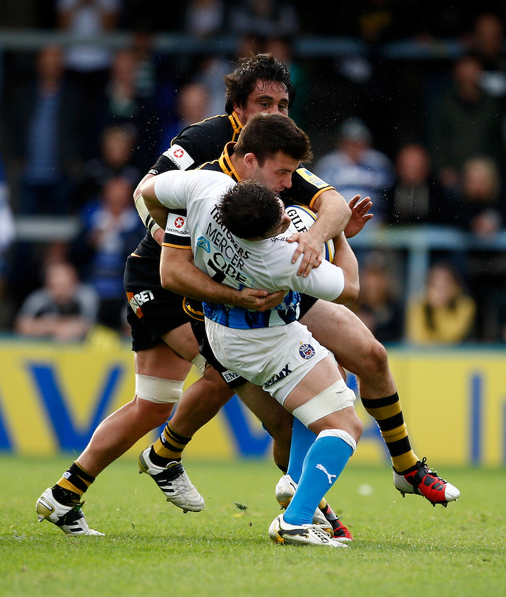 Photo: Richard Lane/Richard Lane Photography. London Wasps v Bath Rugby. 09/10/2011. Wasps' Chris Bell hits Bath's Guy Mercer with a huge tackle.