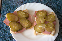 Open faced ham and pickle sandwich for pregnant mom. Balucki District Lodz Central Poland