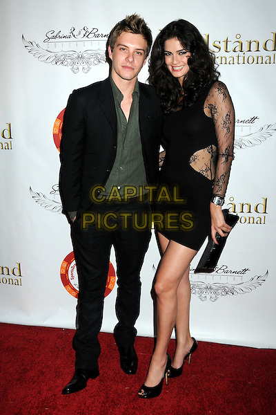 XAVIER SAMUEL & SHERMINE SHAHRIVAR. 4th Annual Sports Dream Celebrity Poker and Pool Party Celebrating the 2010 ESPY Awards held at the Playboy Mansion, Beverly Hills, California, USA..July 12th, 2010.full length jacket trousers suit shirt black green black lace dress clutch bag.CAP/ADM/BP.©Byron Purvis/AdMedia/Capital Pictures.