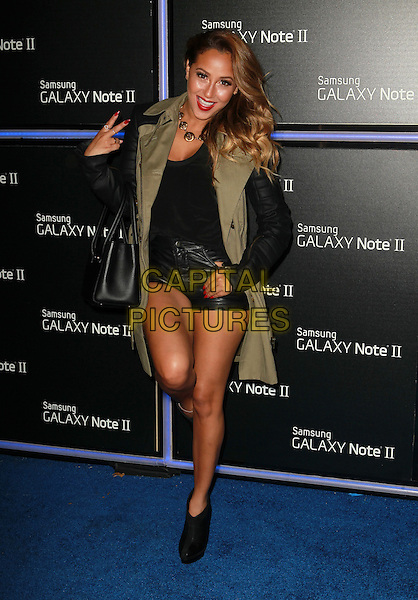 Adrienne Bailon.Samsung Mobile Launch Party For The New Samsung Galaxy Note II Held At Private Residence, Beverly Hills, California, USA, 25th October 2012..full length black leather shorts green khaki jacket coat bag v peace sign hand on hip gesture ankle boots standing on one foot leg knee up.CAP/ADM/KB.©Kevan Brooks/AdMedia/Capital Pictures.
