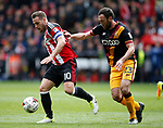 Billy Sharp of Sheffield Utd in action with Rory McArdle of Bradford City during the English League One match at Bramall Lane Stadium, Sheffield. Picture date: April 17th 2017. Pic credit should read: Simon Bellis/Sportimage